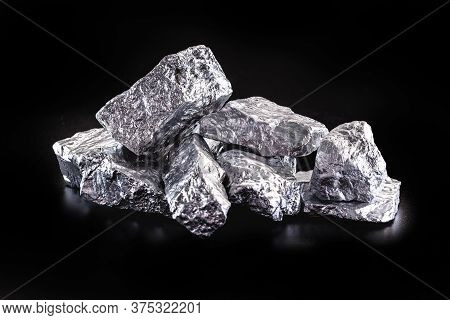 Silver Nugget Native To Liberia Isolated On Black Background. Rare Stone For Industrial Extraction O