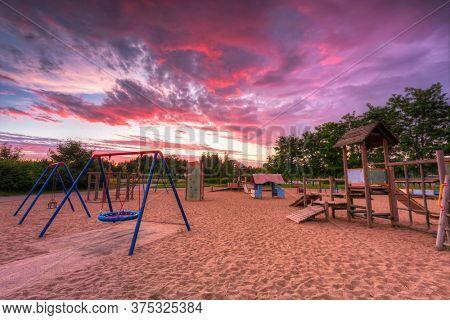 Beautiful sunset over children playground in Pruszcz Gdanski, Poland.