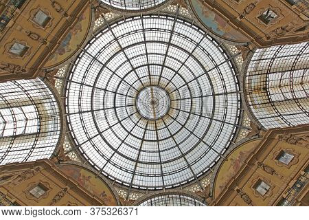 Milan, Italy - July 09, 2013: Skylight Dome And Golden Frescos At Oldest Shopping Mall Arcade Galler