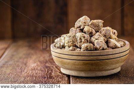 Granulated Pink Soy Protein. Soy Based Protein On Rustic Wooden Background.