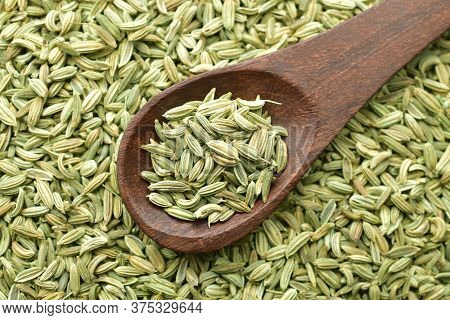 Top View Of Fennel Seeds In Wooden Spoon, Close Up Of Fennel Seeds