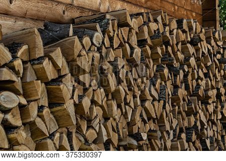 Stack Of Firewood. Firewood Neatly Stacked. Daylight.