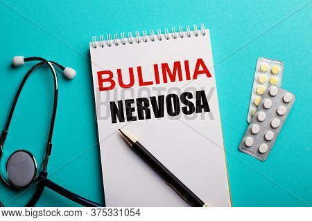 Bulimia Nervosa Written In White Blot Near A Stethoscope And Pills. Medical Concept