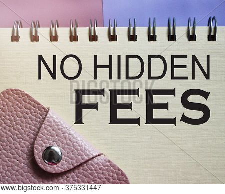 No Hidden Fees Words On Copybook Page And Pink Wallet. Financial Concept