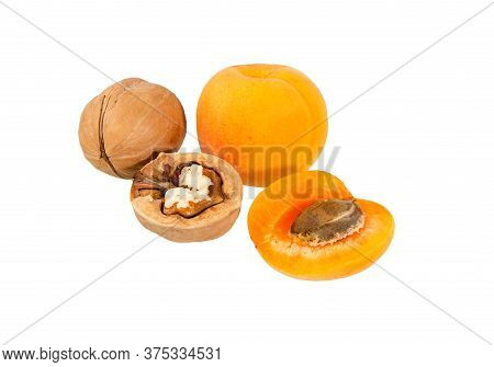 Apricot And Walnuts Isolated. Apricots With Nuts. Fresh Cut Apricot Fruits And Walnuts Isolate On Wh