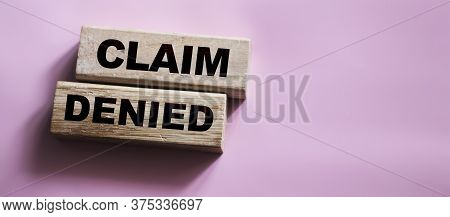 Wooden Blocks With The Text: Claim Denied. Insurance Business Concept