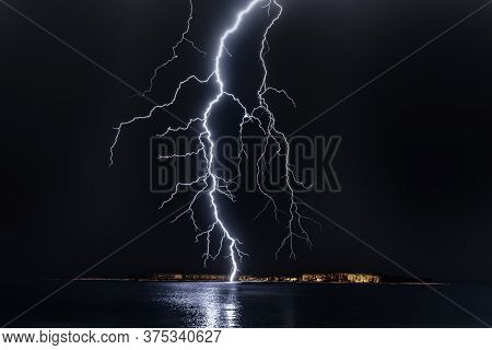 Photography Of White Lightening In The Thunder Storm With Dark Black Ground Of Night.