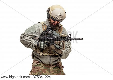 American Soldier In Military Equipment With A Rifle On A White Background Reloads Weapons, Commando