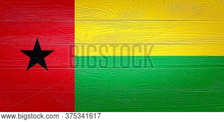 Guinea-bissau Flag Painted On Old Wood Plank Background. Brushed Wooden Board Texture. Wooden Textur