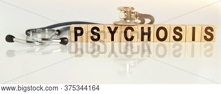 Psychosis The Word On Wooden Cubes, Cubes Stand On A Reflective White Surface, On Cubes - A Stethosc