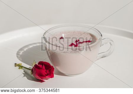 Glass Cup Of Healthy Ayurvedic Drink Moon Milk With Rose