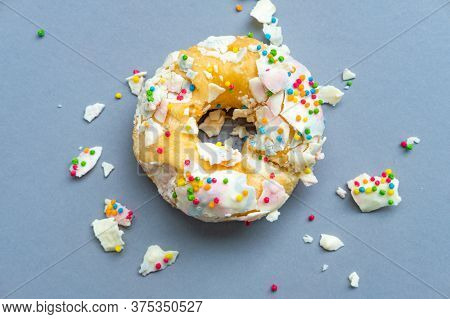 The Destroyed Doughnut Lies On A Uniform Background. Donut, Slice Of Food, Healthy Eating, Chart, Di