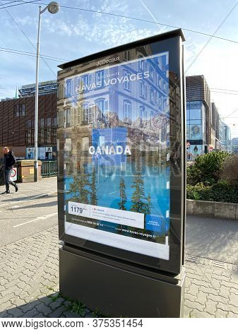 Strasbourg, France - Feb 8, 2020: Havas Voyage Advertising Board In Central City With Canada Trip Ad