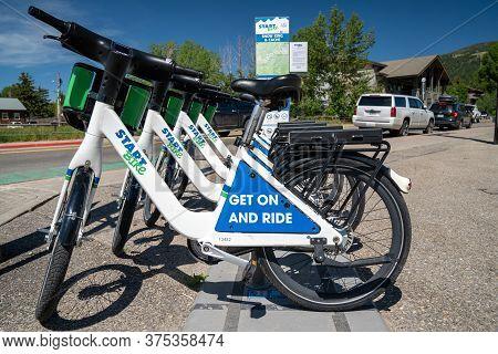 Jackson, Wyoming - June 26, 2020: Bike Rack Of Start Bikes, A Bike Sharing Service In Downtown Jacks