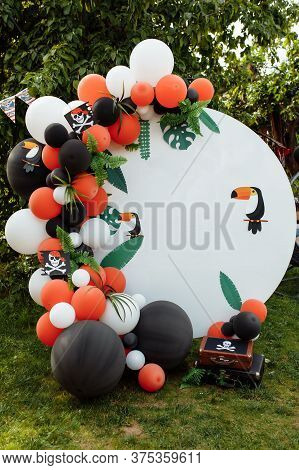 Childrens Photo Zone With A Lot Of Balloons. Decorations For A Birthday Party. Concept Of Childrens