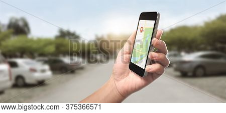 Hand Holding Smartphone Device And Touching Screen, Which Is A Red Icon Of The Location, Concept Of