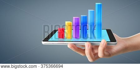 Graph Growth And Increase Of Chart Positive Indicators In His Business, Tablet In Hand