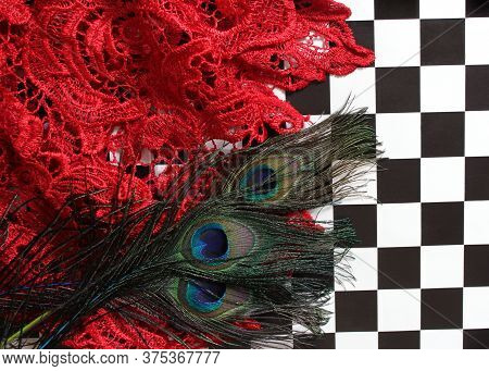 Red Lace And Peacock Feathers On Black And White Checkerboard Background