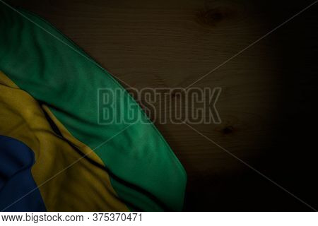 Wonderful Any Occasion Flag 3d Illustration\n - Dark Picture Of Gabon Flag With Big Folds On Dark Wo