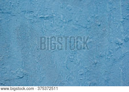 Roughly Painted Wall With Blue Paint. Evidence Of Blue Paint. Beautiful Abstract Grunge Decorative B