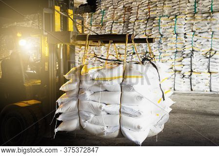 Forklift Carries Jumbo Bag Of Refine White Sugar To Put On The Stack Inside Warehouse. Sugar Warehou
