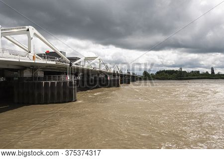 Temse, Belgium, 05 July 2020, Bridge Over The River Scheldt With Threatening Storm Clouds And Turbul