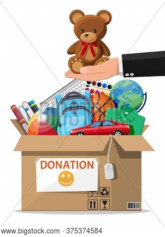 Cardboard Donation Box Full Of Toys, Books, Clothes And Devices. Help For Children, Support For Poor