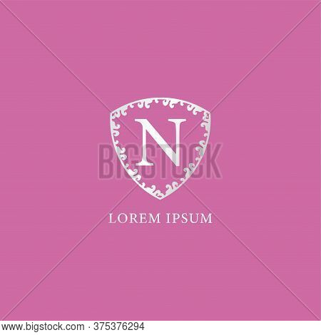 N Letter Intial Logo Design Template. Luxury Silver Decorative Floral Shield Illustration. Isolated