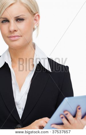 Green eyed businesswoman holding a tactile tablet against white background