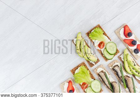 Assortment Of Fresh Summer Fruit Healthy Appetizers Of Whole Grain Rye Crisps Breads With Fresh Vege
