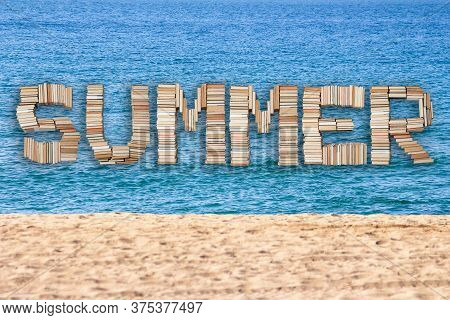 Summer Word Text With Sand And Blue Sea In The Background. Holiday Concept