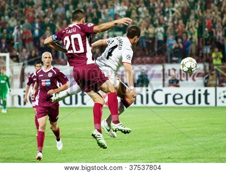 CLUJ-NAPOCA, ROMANIA - OCTOBER 2: Hernandez and Cadu in UEFA Champions League match between CFR 1907 Cluj and Manchester United, Dr. C. Radulescu Stadium on 2 Oct., 2012 in Cluj-Napoca, Romania