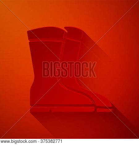 Paper Cut Fishing Boots Icon Isolated On Red Background. Waterproof Rubber Boot. Gumboots For Rainy