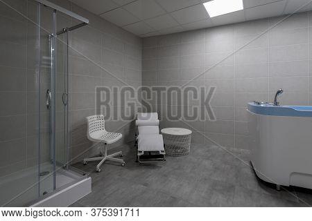 Interior Of Hydro Massage Room In Modern Spa Salon