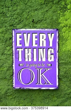 Pop Art Style Purple Signboard Of Everything Is Going To Be Ok On The Rough Green Wall