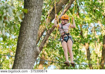 Voronezh, Russia - 24.08.2019 - Girl In High Ropes Experience Adventure Tree Park. Rope Road Course