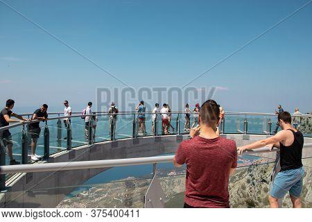 Biokovo, Croatia July 2020 Tourists Walking Accross The Newly Built Skywalk On Biokovo Mountain. Two