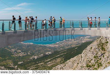 Biokovo Croatia July 2020 Tourists Walking Accross The Newly Built Skywalk On Biokovo Mountain. Wide