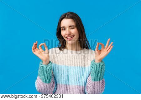 Dont Worry Everything Alright. Relaxed And Chill Good-looking Assertive Young Woman In Winter Sweate