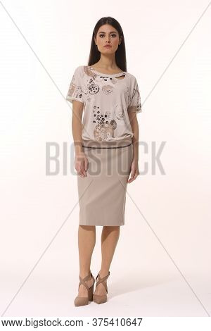 Indian Business Woman Executive Posing In Printed T-shirt Midi Formal Skirt High Heel Shoes
