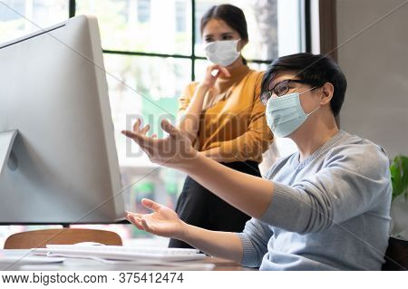 Young Designers In Protective Face Mask For Protect Pandemic Virus Working On Computer Monitor Toget