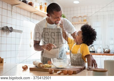 African Family Have Fun Cooking Baking Cake Or Cookie In The Kitchen Together, Happy Smiling Black S