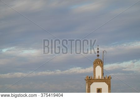 A Mosk Tower In A Blue Sky
