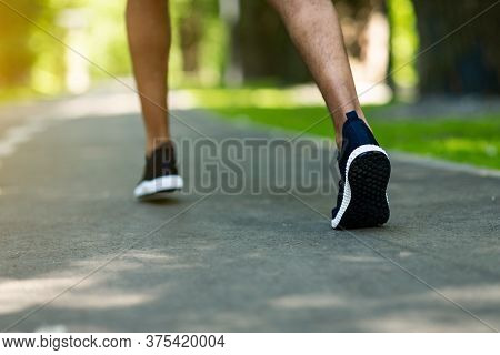 Unrecognizable Jogger In Sports Shoes Running At Park In Morning, Closeup