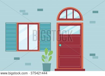 Blue Brick House Facade With Red Front Door With Arched Transom Window