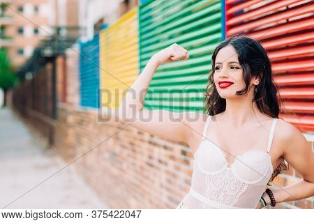 Powerful Young Woman In A Success Pose On Street.