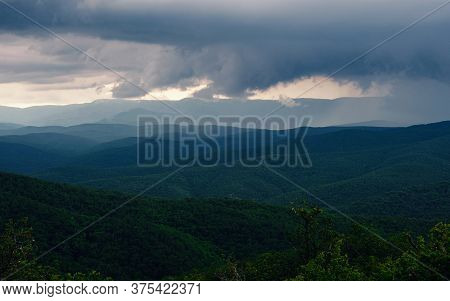 Rain Over Forest Mountains. Misty Mountain Landscape Hills At Rainy Day. Idyllic Green Valley Surrou