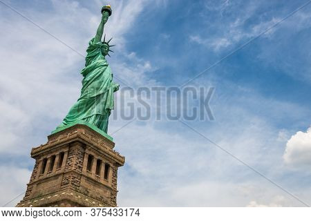 Statue Of Liberty On Liberty Island Closeup With Blue Sky In New York City Manhattan - Image