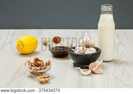 Health Remedy Relief Foods And Drink For Cold And Flu With Yogurt, Lemon, Honey, Garlic And Walnuts