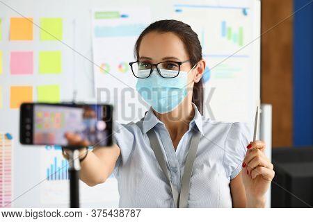 Masked Blogger Is Recording A Broadcast On Smartphone. Quarantine 2020 Online Profession Coronovirus